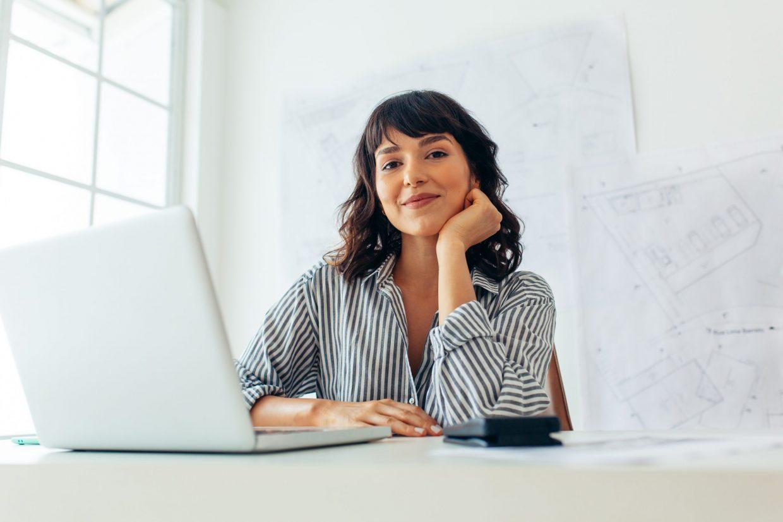 Smiling,Female,Architect,Working,On,Laptop,In,Office.,Entrepreneur,Sitting
